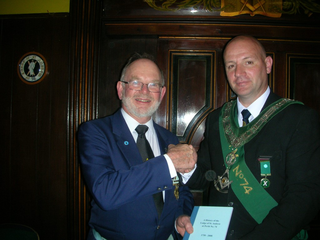 W Bro George Currie Receiving a Copy of the History of the Lodge of St Andrew #74, 1758-2008 in Perth, Scotland, from their RW Master in Sept 2011.